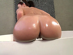 Sophie Dee demonstates her perfectly shaped ass in the bathroom