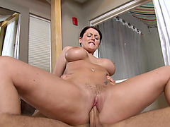 Sophie Dee climbs on his cock and rides reverse cowgirl style