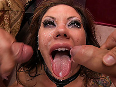 Mason Moore receives two facial cumshots at the same time