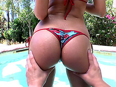 Amy Reid demonstrates her ass and tits in the water pool