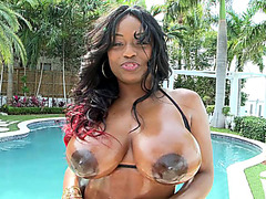 Fucking gorgeous black goddess Jada Fire shows off her oiled juggs and ass outdoor