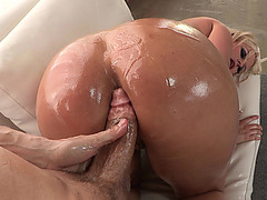 Blonde whore Julie Cash has her ass poured with oil and then rammed by a massive rod