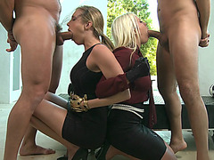 Britney Amber and Samantha Saint sucking two dicks in a foursome