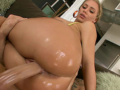 Nicole Aniston mounts her big oiled booty on his dick and fucks it hard