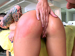 Christy Mack bends over the massage table and takes it balls deep in her pussy