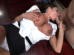 Horny MILF Ariella Ferrera laying on her back sucking his cock