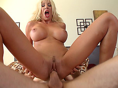 Busty MILF Puma Swede rides his shaft reverse cowgirl style