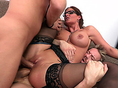 Phoenix Marie in a stockings and glasses goes for a double penetration