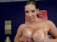 Kelly Divine shakes her huge ass, shows off her oiled tits and plays with her anus