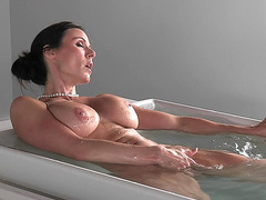 Kendra Lust masturbates while taking bath