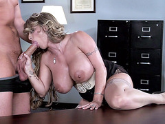Naughty slut Holly Halston sucking his dick in the office