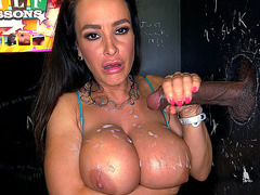 Lisa Ann strokes that dick and gets cum on her breasts