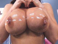 Lisa Ann teasing him with her oily tits and ass