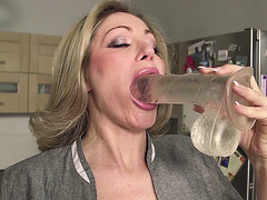 Vittoria Risi playing with a big glass dildo