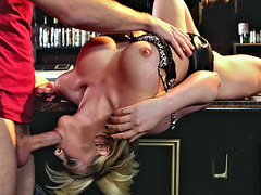 Kagney Linn Karter laying on the bar stand getting her mouth fucked