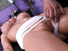 Eva Karera lets him oil her up and massage her body