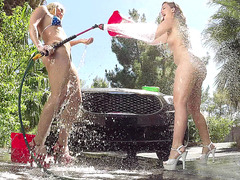 Maddy O'Reilly and AJ Applegate having fun while washing a car