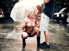 Lexi Davis blowing him on the parking lot under the rain