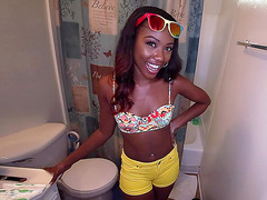 Chanell Heart talking with a cameraman and demonstrating her shower