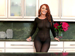 Redhead mommy Janet Mason posing in a see-through outfit