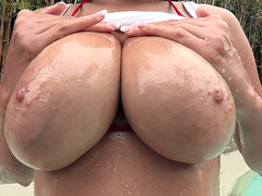 Cassidy Banks shows off those oily 38 D's