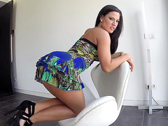 Sexy babe Athina posing in a sexy dress