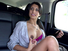 Latina babe Soffie posing in the car