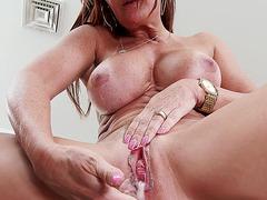Janet Mason takes a big load inside her crack